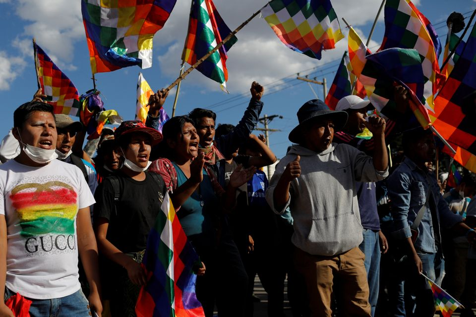 Supporters of former Bolivia's President Evo Morales participate in a demonstration in Cochabamba, Bolivia,...