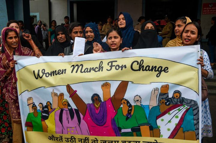 Women hold a banner during a protest against atrocities on women in Mumbai on 1 August, 2019.
