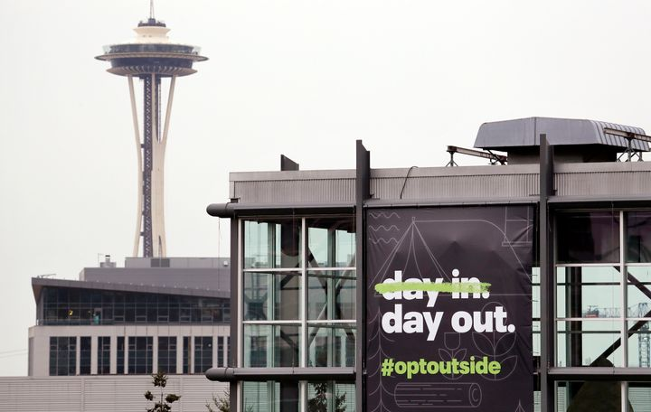 REI's flagship Seattle store with a banner announcing its plan to close on Black Friday 2018.