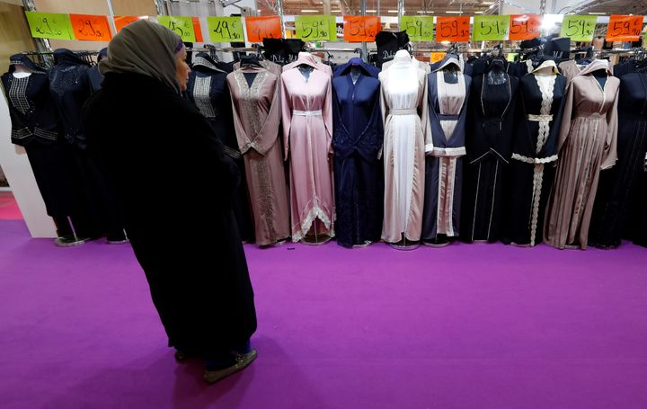 A visitor looks at women's clothes during a meeting organized by the Union of Islamic Organizations of France at Le Bourget,