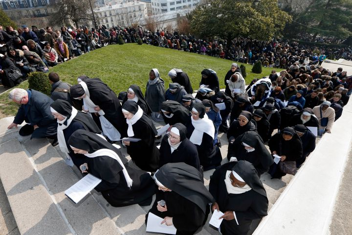 """Catholic nuns attend the annual Good Friday """"Stations of the Cross"""" procession in the gardens of the Montmartre's Sacre Coeur"""