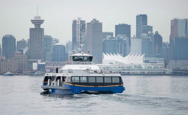 Downtown Vancouver is pictured in the background as a Seabus leaves North Vancouver, B.C. on Wednesday,...