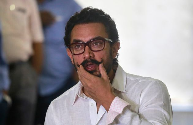 Bollywood actor Aamir Khan speaks to media on his 52th birthday in Mumbai, India, Tuesday, March 14,...