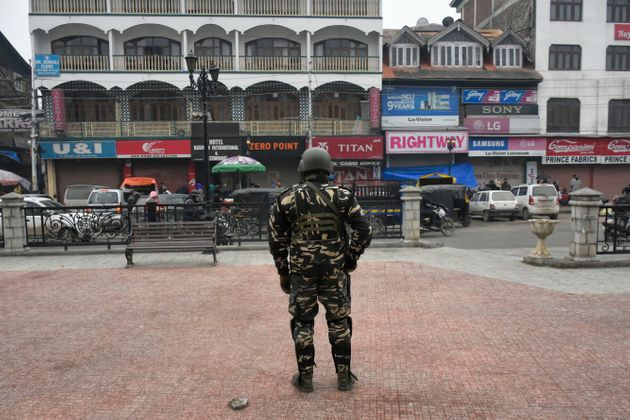 An Indian paramillitary trooper stands in city centre Lal chowk as shutdown continues in parts of Srinagar,...