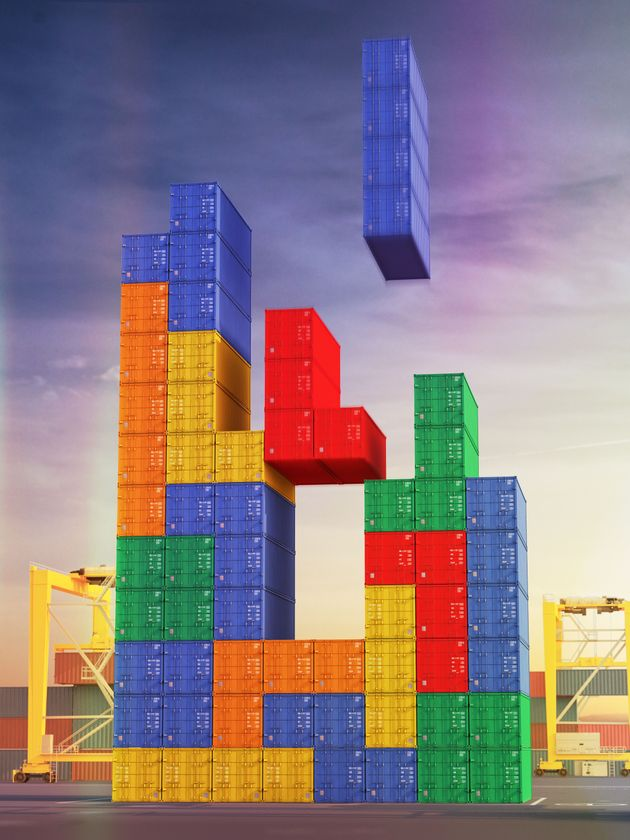 A big stack of shipping containers in port arranged as a block stacking