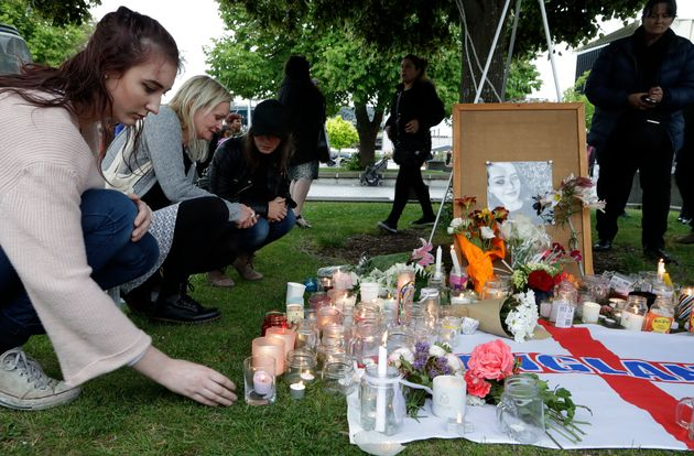 People pay respects during candlelight vigil for murdered British tourist Grace