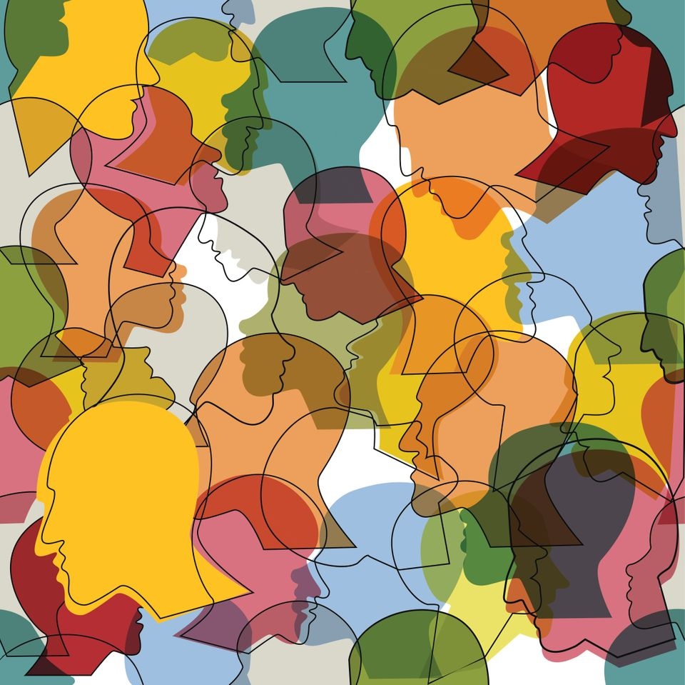 Seamless pattern of a crowd of many different people profile heads. Vector