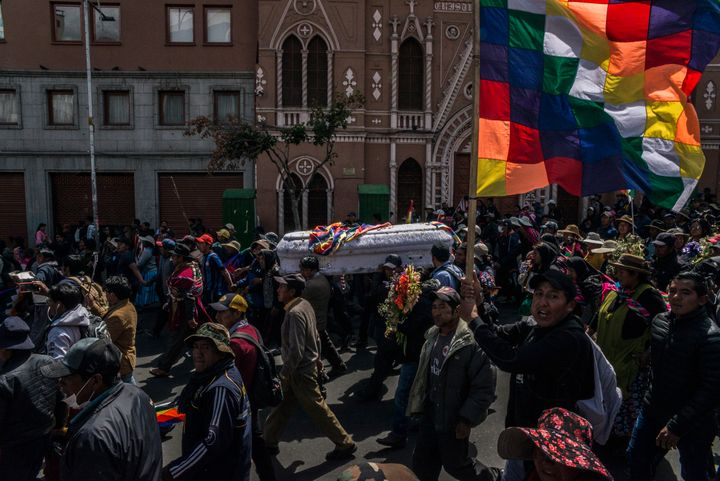 Supporters of the resigned Bolivian head of state Morales march in La Paz, the capital, carrying a coffin with the remains of