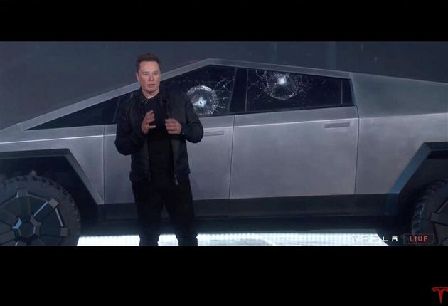 Tesla chief executive Elon Musk stands in front the company's first electric pickup truck, the Cybertruck,...