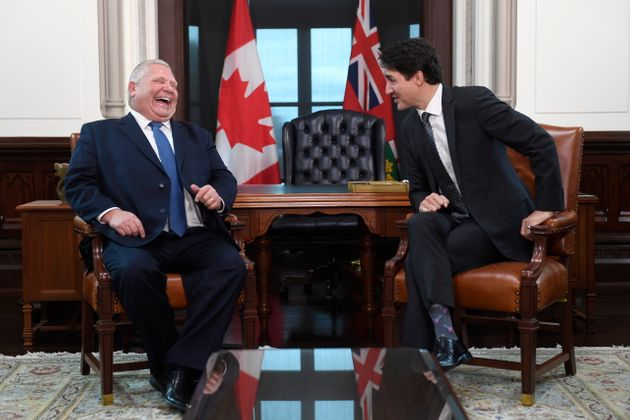 Prime Minister Justin Trudeau and Premier of Ontario Doug Ford share a laugh after Ford spoke French...
