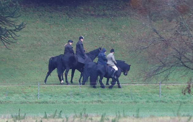 Prince Andrew (second from left) rides a horse on the grounds of Windsor Castle, alongside the queen...