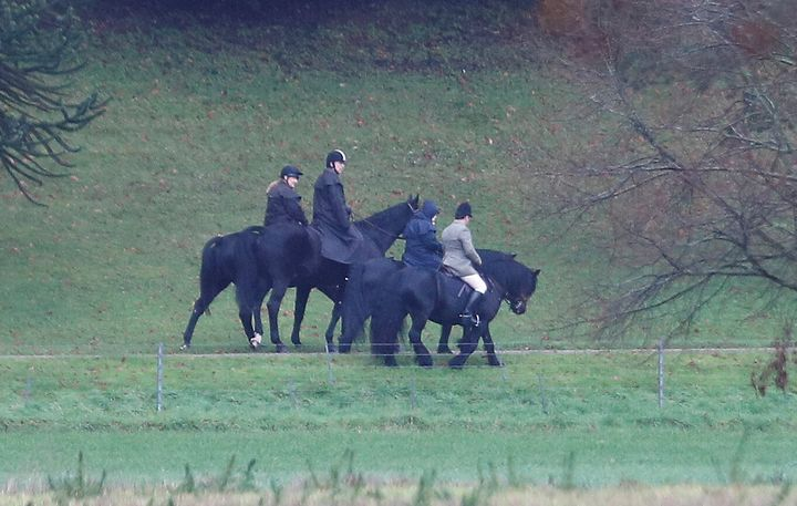 Prince Andrew (second from left) rides a horse on the grounds of Windsor Castle, alongside the queen on Friday.