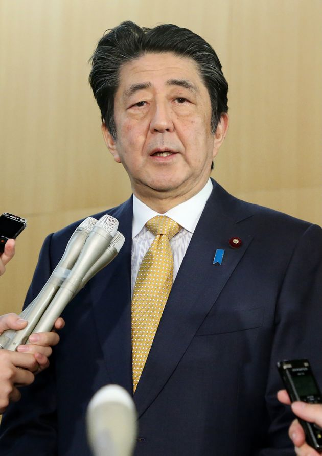 Japan's Prime Minister Shinzo Abe speaks to the media, after South Korea's decision on the military intelligence-sharing...
