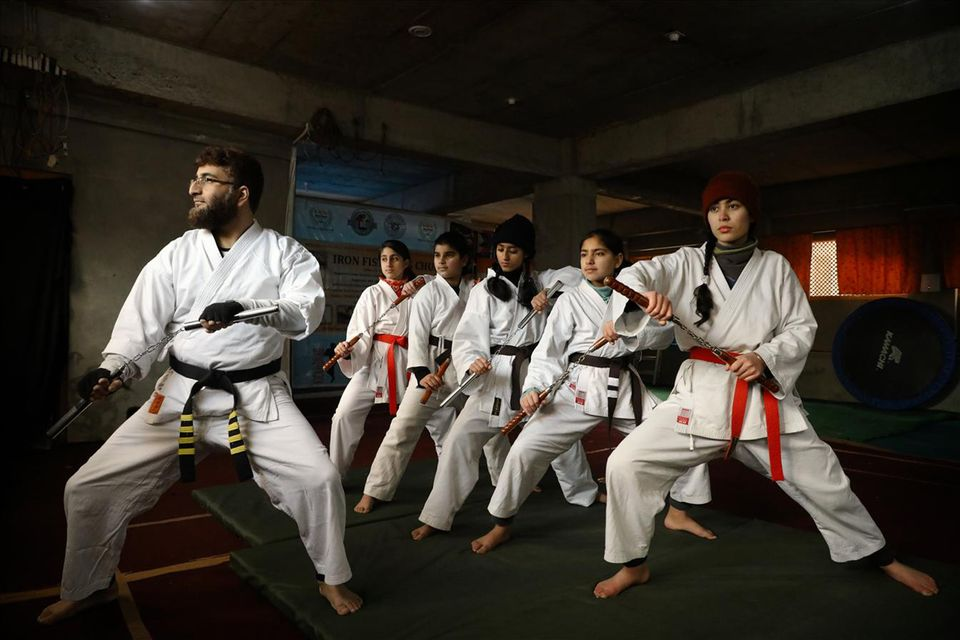 Peerzada Adil Iqbal Shah leading girl students during a training session at his martial arts academy...