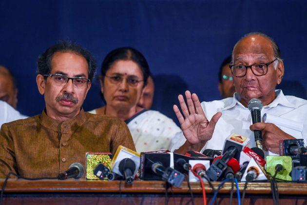 Shiv Sena party Chief Uddhav Thackeray (L) looks on as Nationalist Congress Party (NCP) Chief Sharad...