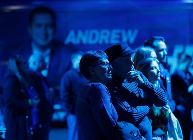 Scheer supporters watch the election results come in at his campaign headquarters during the federal...
