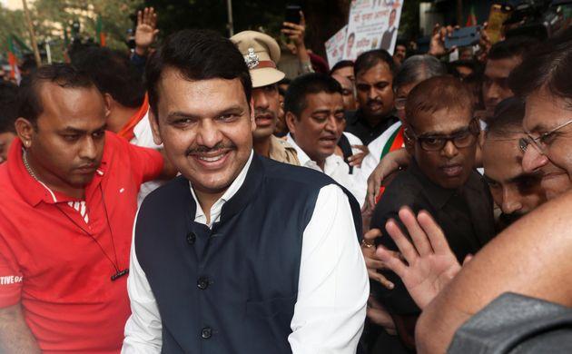 Maharashtra chief minister Devendra Fadnavis leaves the Bharatiya Janata Party (BJP) headquarters after...