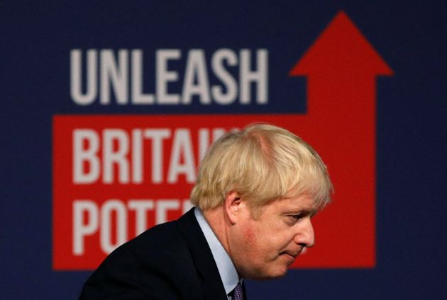 Britain's Prime Minister Boris Johnson leaves after speaking at the Conservative party's manifesto launch...