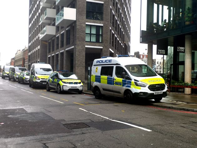 Police at the scene on Buckle Street, Whitechapel, east London, after a man died and another three were...