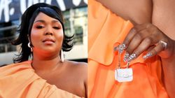 All Hail Lizzo And Her Impossibly Tiny Purse On The AMAs Red