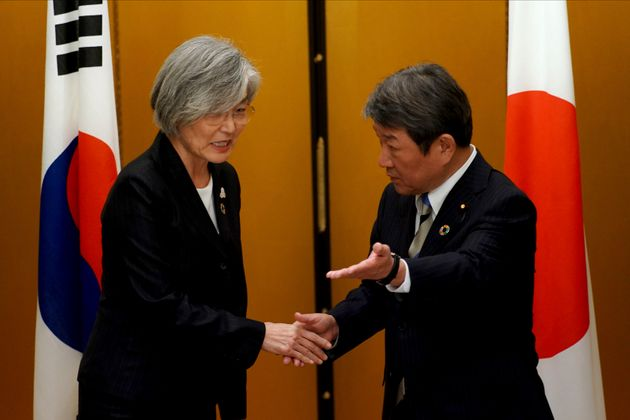 Japan's Foreign Minister Toshimitsu Motegi, right, meets with South Korea's Foreign Minister Kang Kyung-wha...