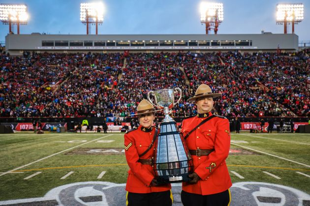 The Grey Cup arrives at the stadium prior to the game in