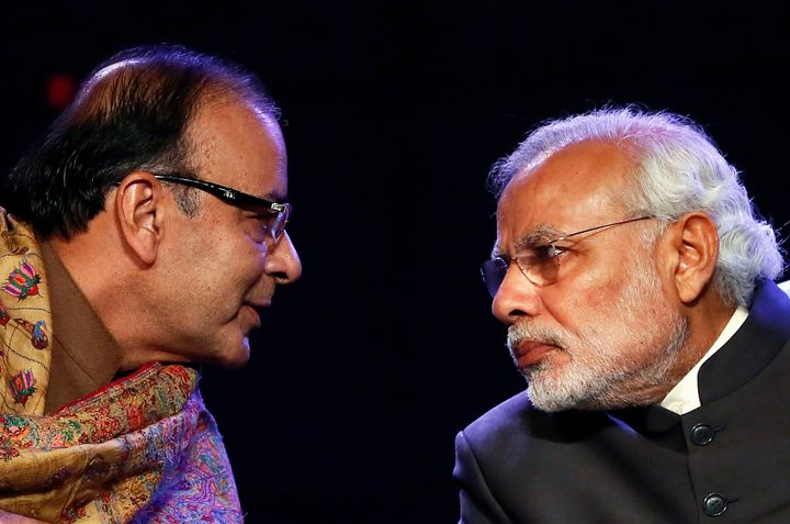 Prime Minister Narendra Modi and former finance minister Arun Jaitley during the Global Business Summit in New Delhi January 16, 2015.