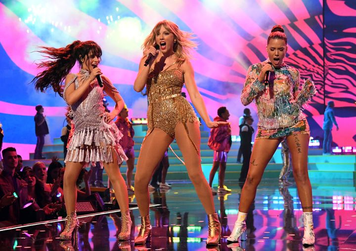 From left to right, Camila Cabello, Taylor Swift, and Halsey perform onstage during the 2019 American Music Awards at Microsoft Theater on Sunday in Los Angeles.