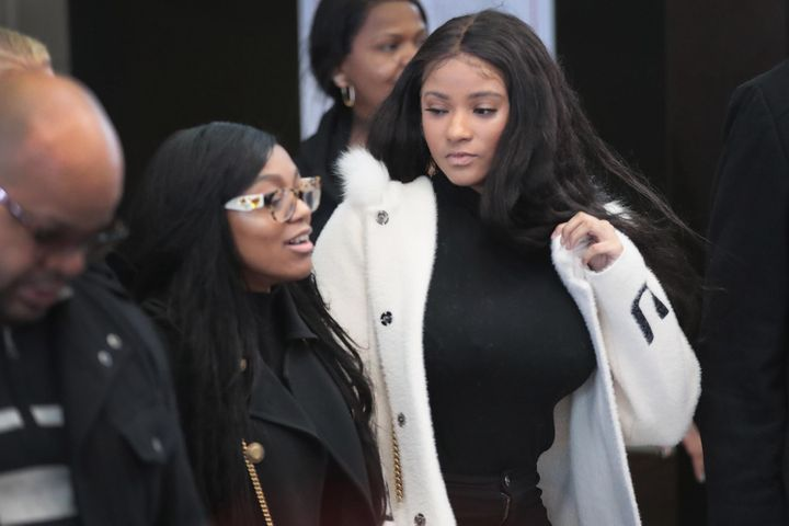 Joycelyn Savage (R) and Azriel Clary arrive for a bond hearing for R&B singer R. Kelly at the Leighton Criminal Court Bui