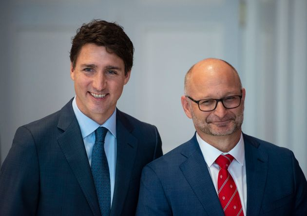 Prime Minister Justin Trudeau poses for a photo with David Lametti as he retains the position of Minister...