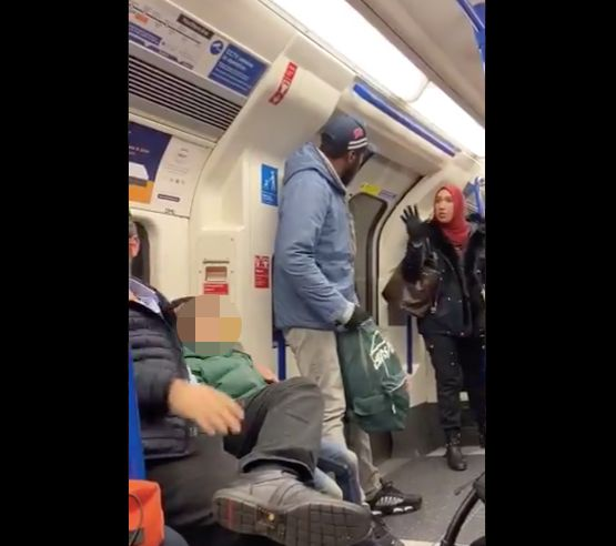 Asma Shuweikh speaks to a man on a London subway car who is accused of harassing a Jewish