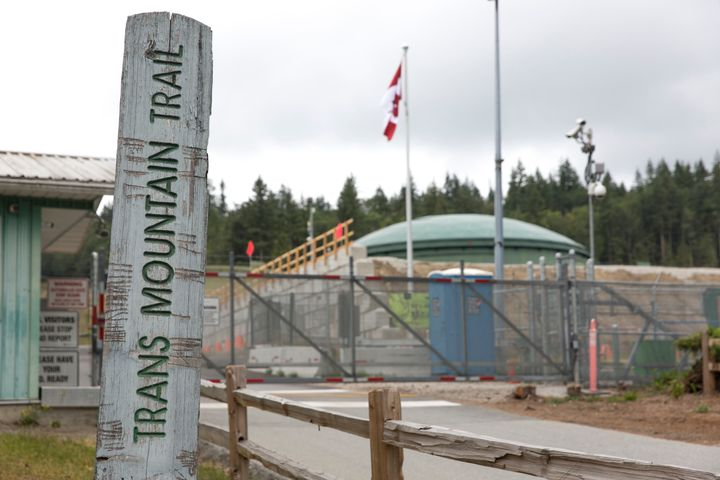 A marker for the Trans Mountain Trail is pictured outside a Kinder Morgan terminal and tank farm in Burnaby, B.C. on June 20, 2019.