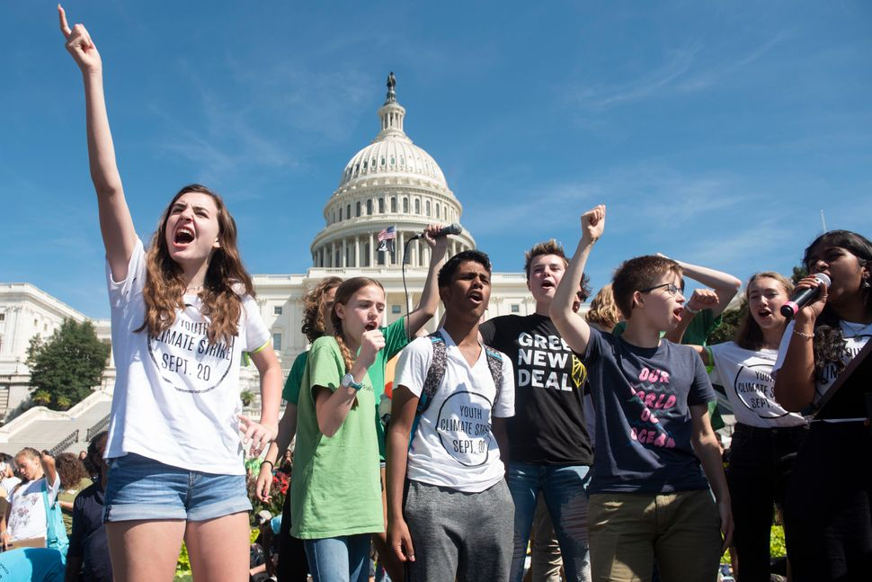 Young climate activists rally the crowd at the end of the Climate Strike protest on Sept. 20, 2019, in Washington D.C.