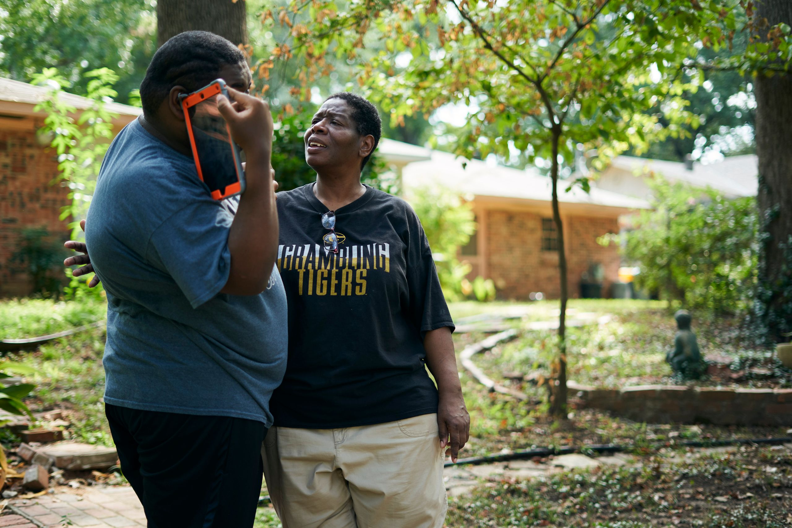 Rosie Phillips talks with her son, J.H., in the backyard at their home in Shreveport.