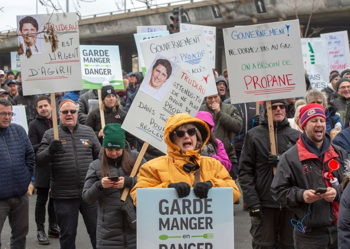 Farmers protest the ongoing CN Rail strike in front of the riding office of Prime Minister Justin Trudeau on Nov. 25, 2019 in Montreal.