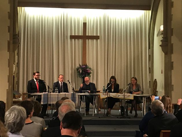 Foreign Secretary Dominic Raab (centre left) attends a hustings at East Molesey Methodist Church in his
