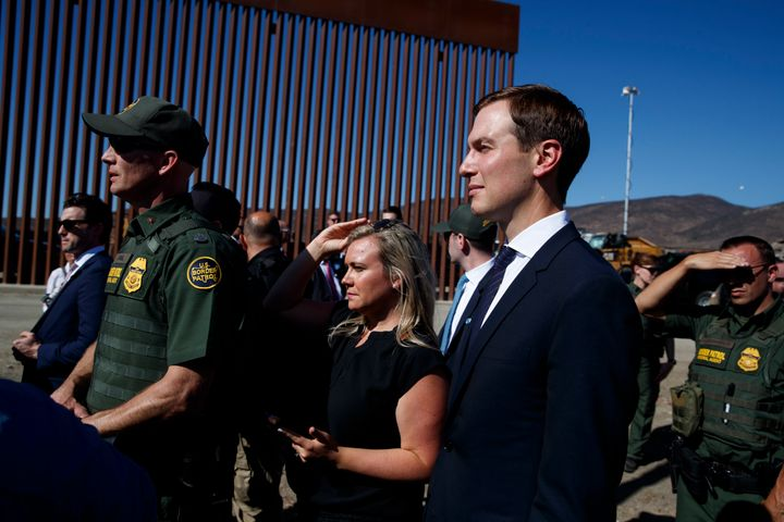 White House senior adviser Jared Kushner, right, watches as President Donald Trump tours a section of the southern border bar