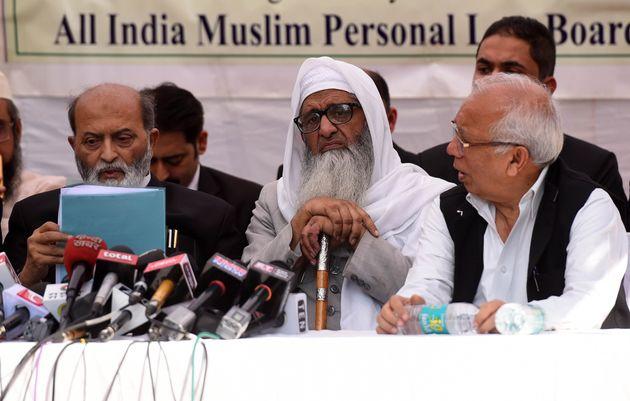 Sunni Central Waqf Board counsel members Zafaryab Jilani (L), All India Muslim Personal Law Board members...