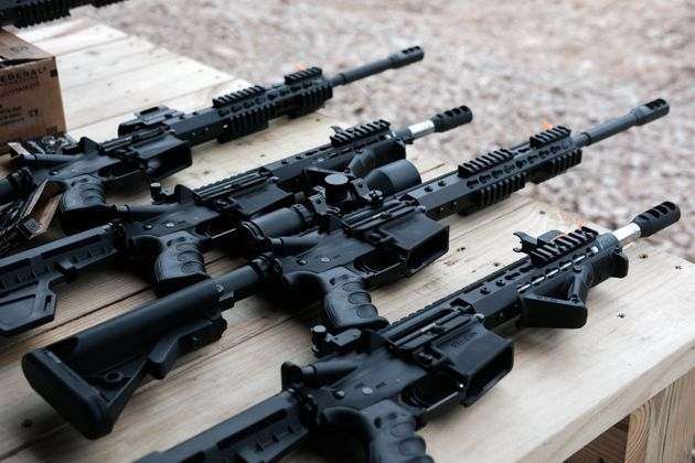 AR-15 rifles and other weapons sit on a table at a shooting range in Pennsylvania. Earlier this year,...