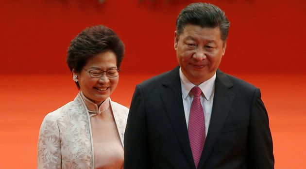 Hong Kong Chief Executive Carrie Lam (L) and Chinese President Xi Jinping walk after Lam took her oath,...