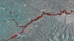 Uno squarcio rosso sangue. Le alluvioni in Nord Italia sono come ferite viste dallo