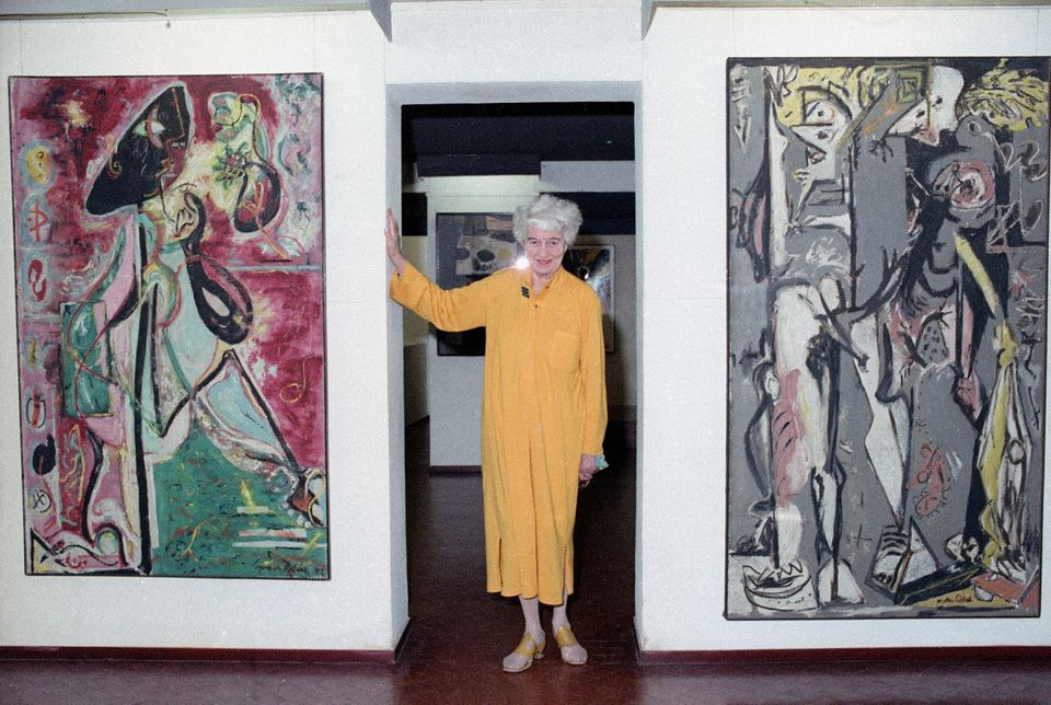 American art collector Peggy Guggenheim poses between early paintings by Jackson Pollock that are part of her modern art collection at her 18th century palace, Palazzo Venier dei Leoni, in Venice, Italy, July 17, 1979.  (AP Photo)