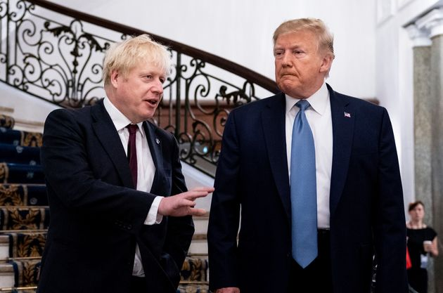 President Donald Trump and Britain's Prime Minister Boris Johnson, left, speak to the media before a working breakfast meeting at the Hotel du Palais on the sidelines of the G-7 summit in Biarritz, France, Sunday, Aug. 25, 2019.