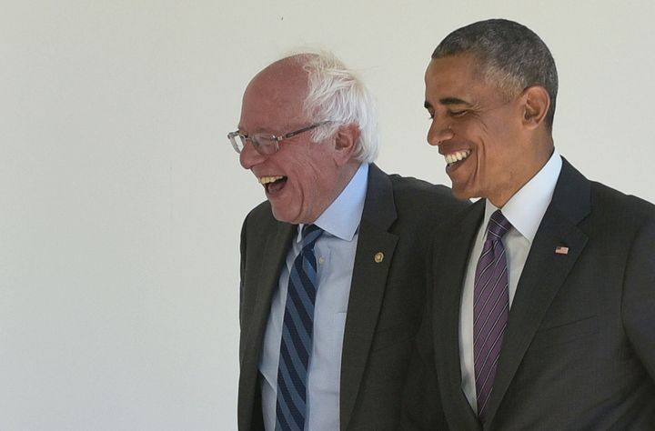 Then-President Barack Obama, right, walks with 2016 Democratic presidential candidate Sen. Bernie Sanders of Vermont at the White House on June 9, 2016.
