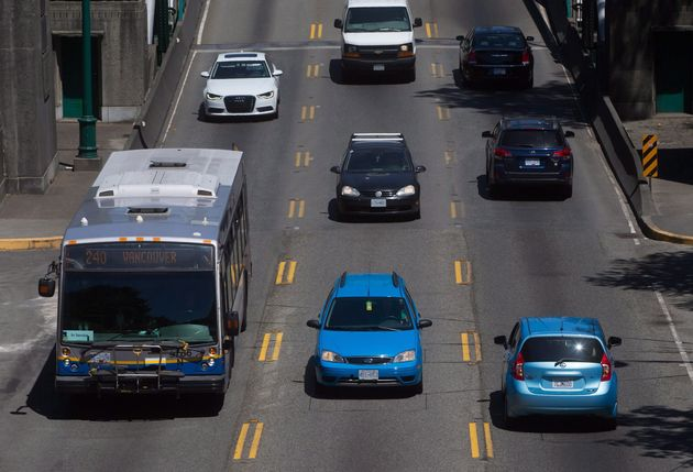 A transit bus enters the Stanley Park causeway after crossing over the Lions Gate Bridge from North Vancouver...
