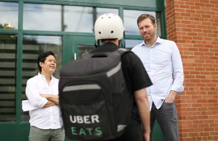 An Uber Eats delivery worker is seen here working in Toronto. A role with Uber is one of the many precarious jobs available for workers across Canada.