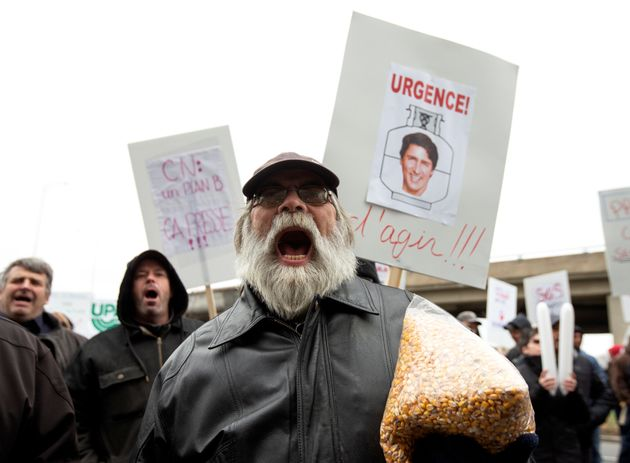 Farmers carrying corn grain protest in front of the Papineau riding office of Canadian Prime Minister...