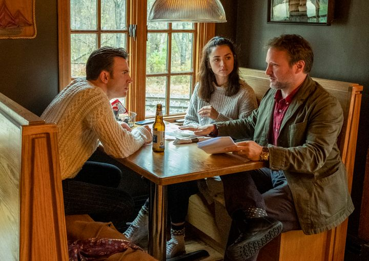 "Rian Johnson (right) directs Chris Evans and Ana de Armas in a scene from ""Knives Out."""
