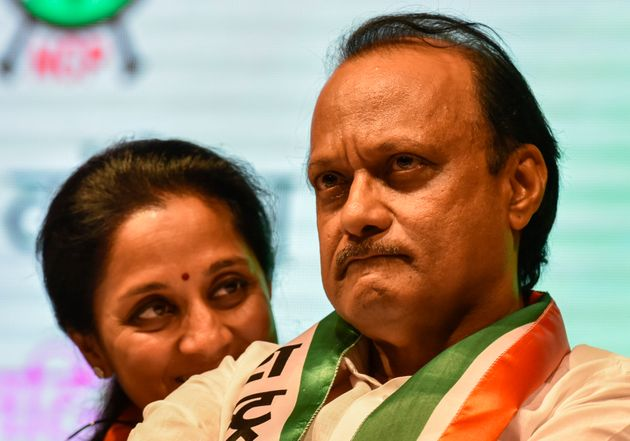 A file photo of Ajit Pawar with cousin Supriya Sule, daughter of Sharad Pawar, in Mumbai.