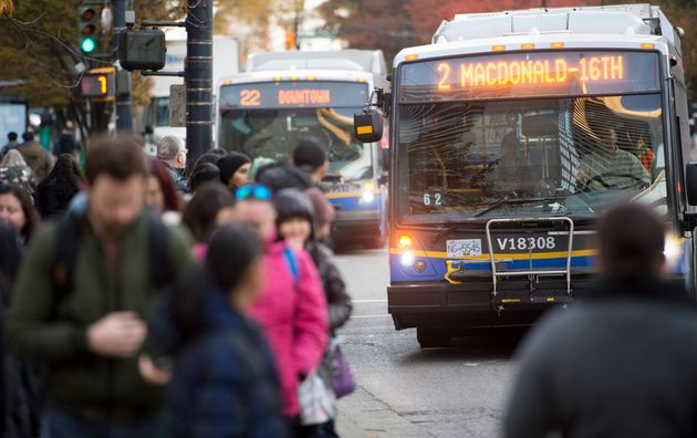 A bus is seen stopping for passengers in downtown Vancouver on Nov. 1, weeks before a new agreement was...